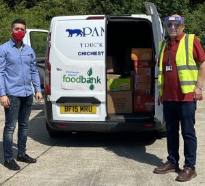 Enes Basar UK Business Development Manager Bebeto and one of the volunteers from the Chichester Food Bank